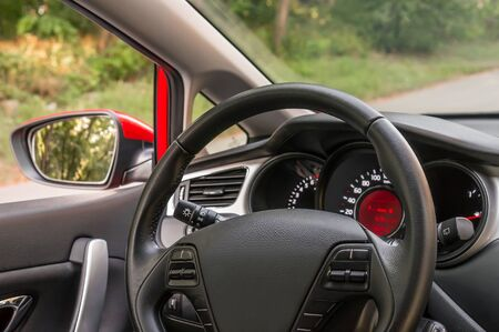expensive: Vehicle interior with steering wheel and dashboard - car salon concept