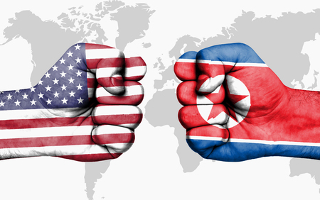 Conflict between USA and North Korea, male fists - governments conflict concept 스톡 콘텐츠