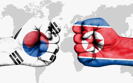 Conflict between South Korea and North Korea, male fists - governments conflict concept