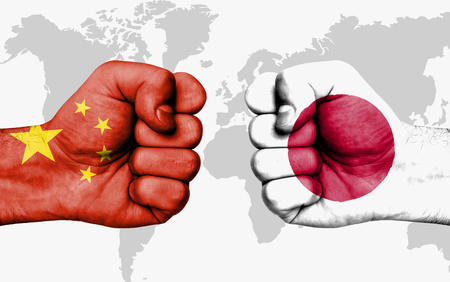 bandera japon: Conflict between China and Japan, male fists - governments conflict concept