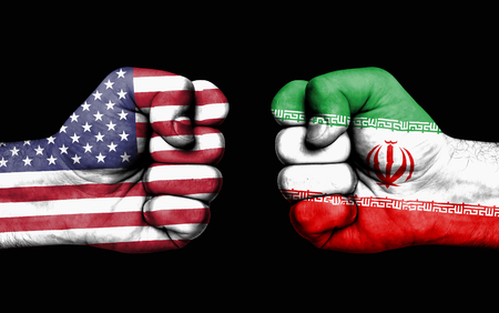 Conflict between USA and Iran, male fists - governments conflict concept
