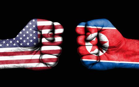 Conflicto entre EE. UU. Y Corea del Norte, puños masculinos: concepto de conflicto entre los gobiernos Foto de archivo - 88347621