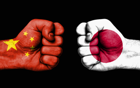 Conflict between China and Japan, male fists - governments conflict concept