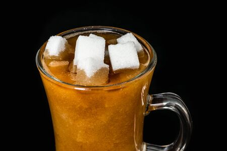 Many sugar cubes inside a cup of coffee - unhealthy eating concept