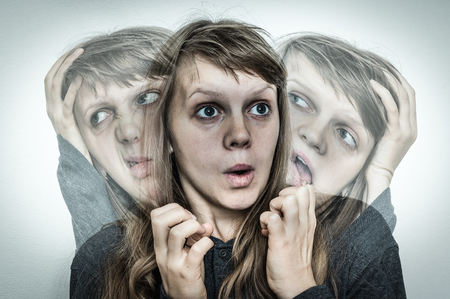 Woman with split personality suffers from schizophrenia - schizophrenia disease concept