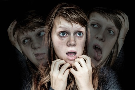 Woman with split personality suffers from schizophrenia - schizophrenia disease concept Imagens - 90456574