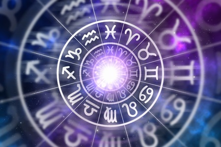 esoterismo: Astrological zodiac signs inside of horoscope circle on universe background - astrology and horoscopes concept