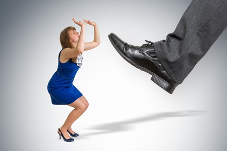 Scared and shocked small business woman under boss pressure - boss pressure concept Stock Photo