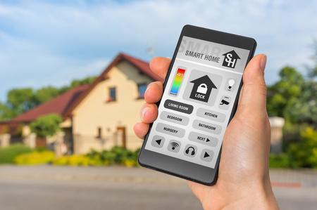 Smartphone with remote smart home control system - futuristic smart home concept Reklamní fotografie