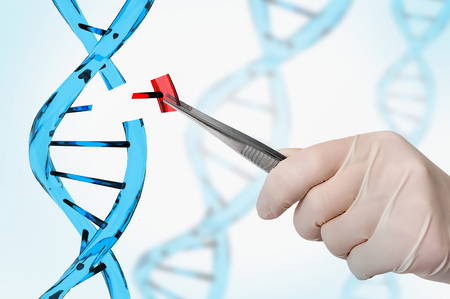 Hand of scientist replacing DNA - genetic engineering and gene manipulation concept