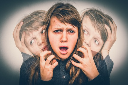 Woman with split personality suffers from schizophrenia - schizophrenia disease concept - retro style Stockfoto