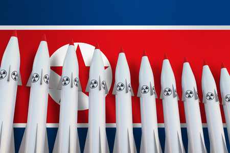Nuclear missiles in a row and flag of North Korea on background - 3D rendered illustration