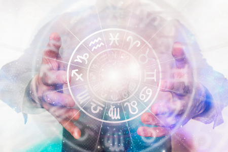 Man with horoscope circle in his magic hands - concept of predictions of the future Banco de Imagens