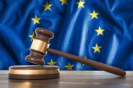 Wooden gavel and flag of European Union on background - law concept. 3D rendered illustration. Stock Photo