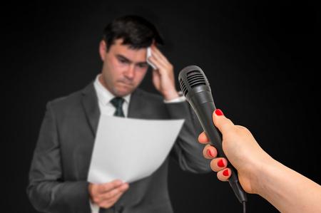 Nervous man is sweating, he afraid of public speech Фото со стока