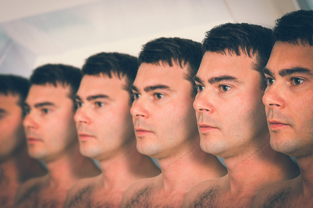 A lot of men in a row - genetic clone concept - retro style