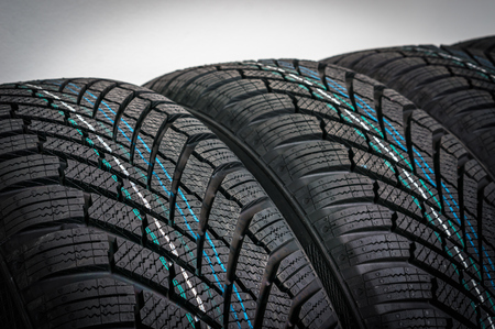 Winter car tires in row isolated on gray background Stock fotó