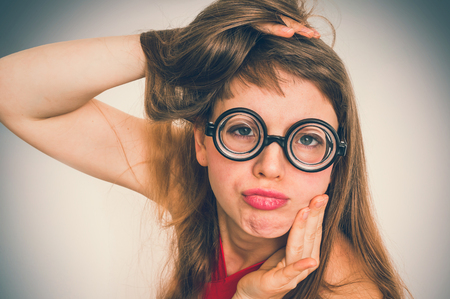 Young funny nerd or geek woman with sexual expression on face - retro style