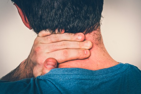 Man with muscle injury having pain in his neck - body pain concept - retro style