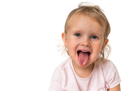 Little baby girl showing tongue isolated on white background Stockfoto