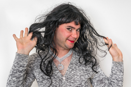 Attractive man wearing makeup looks like as a woman - transsexual and concept