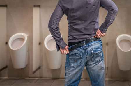 Man wants to pee - urinary incontinence concept
