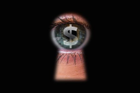 Human eye with dollar symbol looking through a keyhole