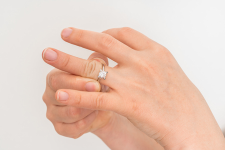 Woman cannot take off stuck wedding ring - fat fingers and big knuckles