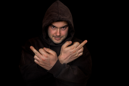 Man showing middle finger gesture - isolated on black background Imagens