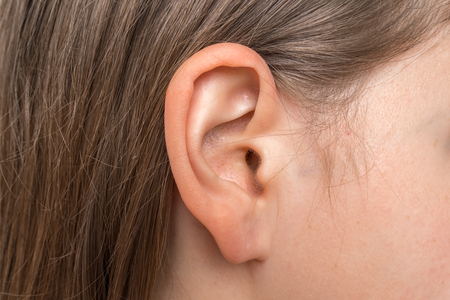 Close up of human head with female ear - listening or deafness concept Reklamní fotografie - 122661523