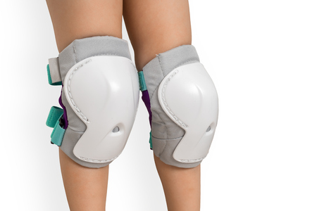 Pair of knee pads wearing on legs of child - protectors for knees
