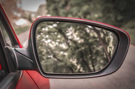 Close-up view of rearview mirror from the red car