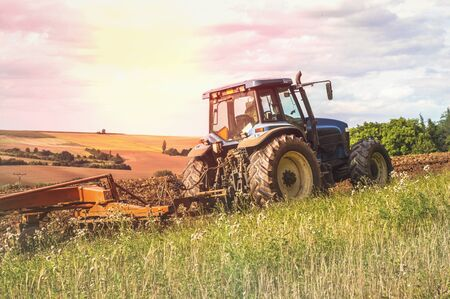 Tractor at work on a field in the Czech Republic
