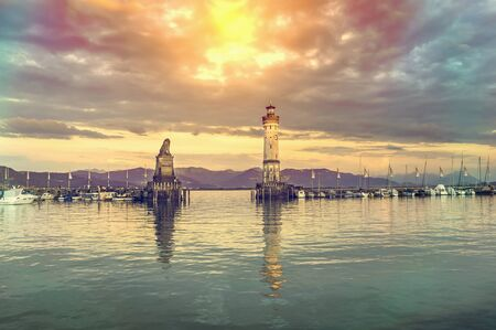 Beautiful evening seascape with lighthouse in harbor of Lindau in lake Constance, Germany Banque d'images