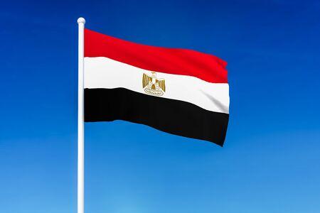 Waving flag of Egypt on the blue sky background - 3D rendered 版權商用圖片