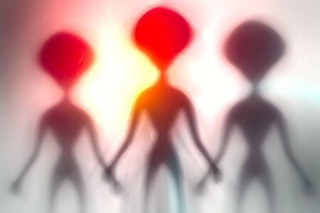 Silhouettes of spooky aliens and bright light on behind them. UFO concept.