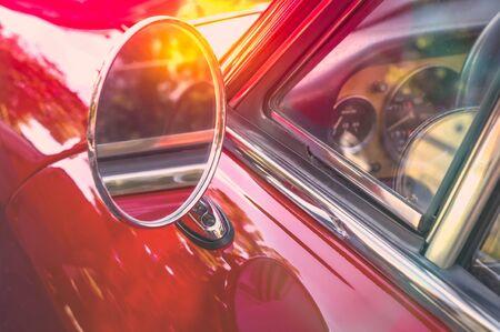 Round side mirror of a red retro car Reklamní fotografie