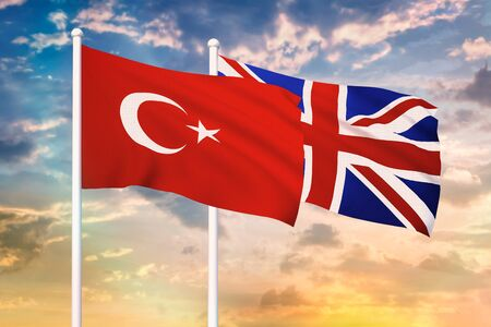 Relationship between the Turkey and the United Kingdom. Two flags of countries on heaven with sunset. 3D rendered illustration.
