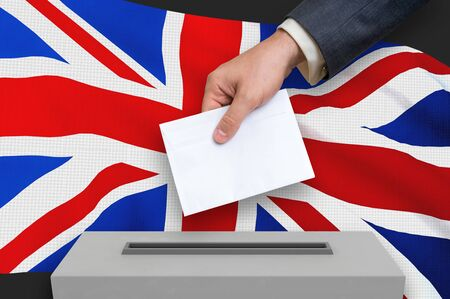 Election in United Kingdom - voting at the ballot box. The hand of man is putting his vote in the ballot box. 3D rendered illustration.