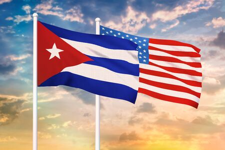 Relationship between the Cuba and the USA. Two flags of countries on heaven with sunset. 3D rendered illustration. 写真素材