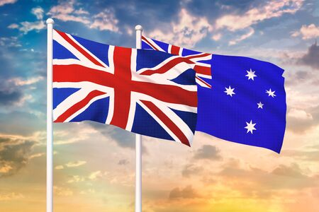 Relationship between the United Kingdom and the Australia. Two flags of countries on heaven with sunset. 3D rendered illustration. 版權商用圖片