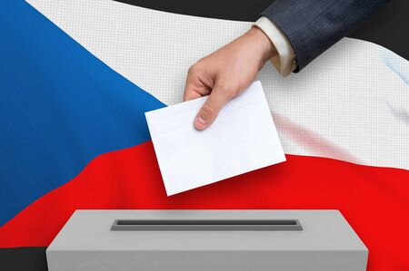 Election in Czech Republic - voting at the ballot box. The hand of man is putting his vote in the ballot box. 3D rendered illustration.