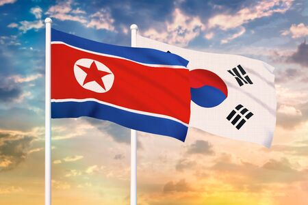 Relationship between the North Korea and the South Korea. Two flags of countries on heaven with sunset. 3D rendered illustration. Stok Fotoğraf - 133458302