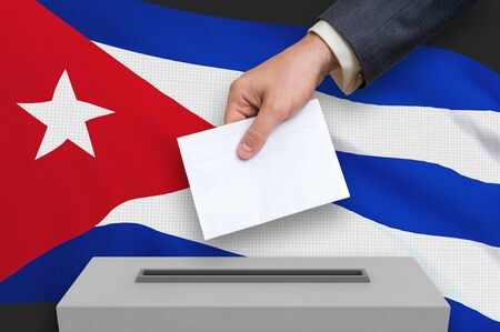 Election in Cuba - voting at the ballot box. The hand of man is putting his vote in the ballot box. 3D rendered illustration. 写真素材