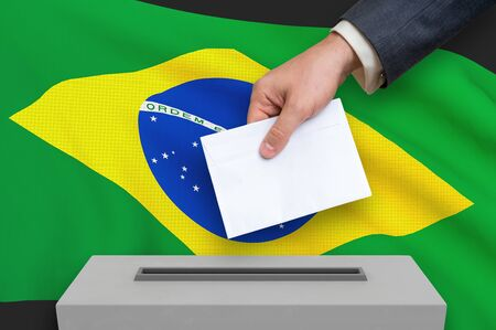 Election in Brazil - voting at the ballot box. The hand of man is putting his vote in the ballot box. 3D rendered illustration. Фото со стока
