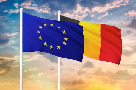 Relationship between the European Union and the Belgium. Two flags of countries on heaven with sunset. 3D rendered illustration. Imagens