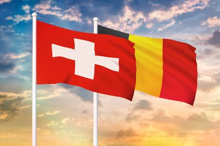 Relationship between the Switzerland and the Belgium. Two flags of countries on heaven with sunset. 3D rendered illustration. Imagens