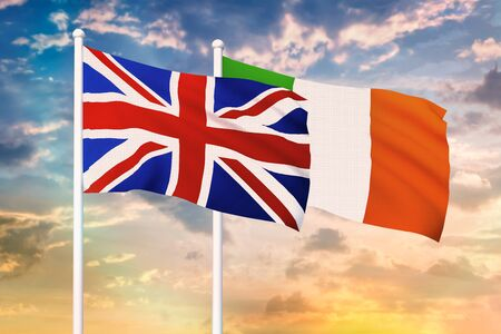 Relationship between the United Kingdom and the Ireland. Two flags of countries on heaven with sunset. 3D rendered illustration.