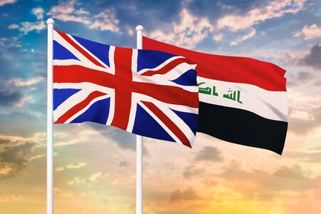 Relationship between the United Kingdom and the Iraq. Two flags of countries on heaven with sunset. 3D rendered illustration.