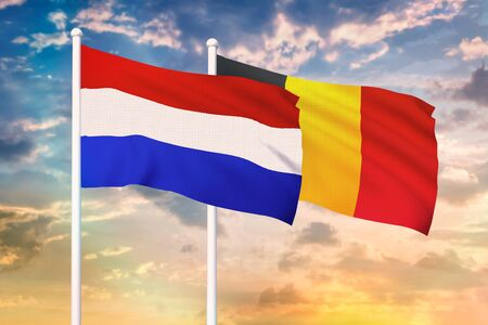 Relationship between the Netherlands and the Belgium. Two flags of countries on heaven with sunset. 3D rendered illustration. Imagens